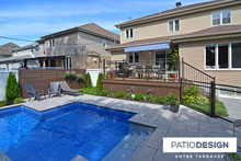 Patio with a pool by Patio Design inc.